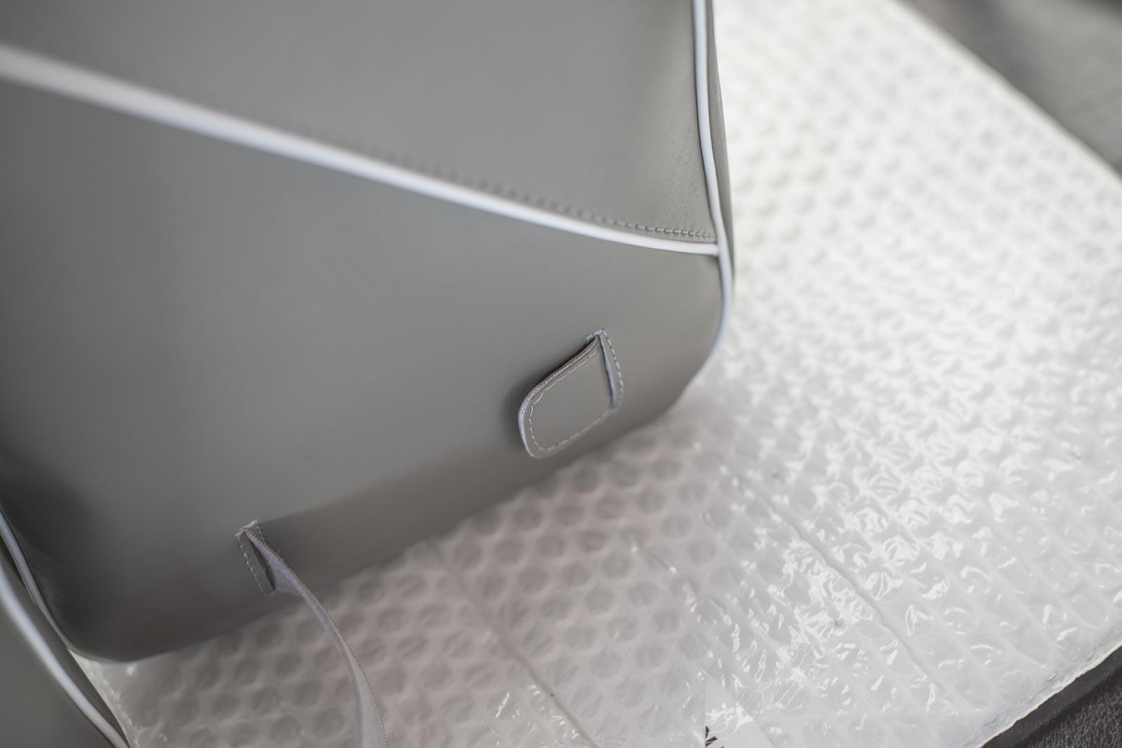 borse-scudo-dettaglio-tasca-fissaggio